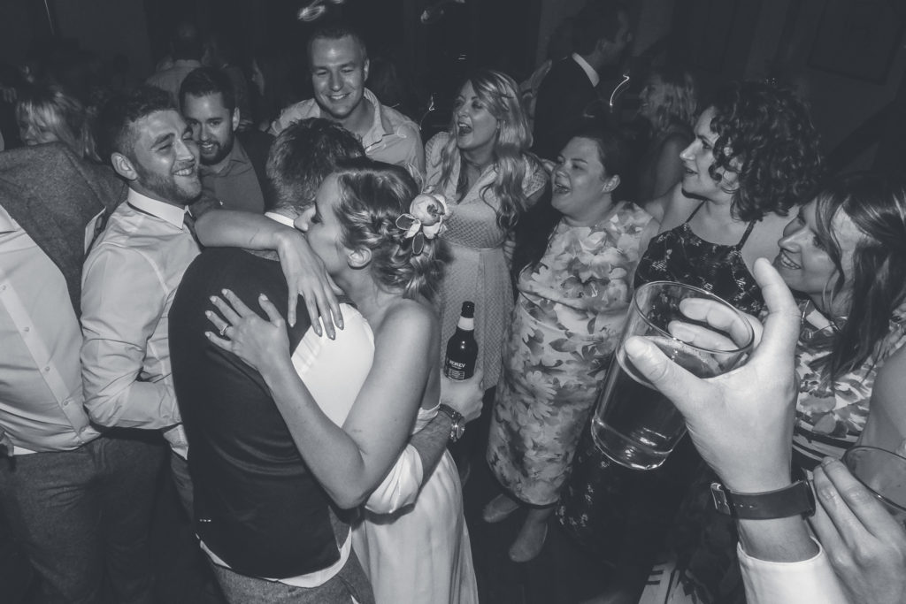 Bride and groom hugs at the end of their wedding