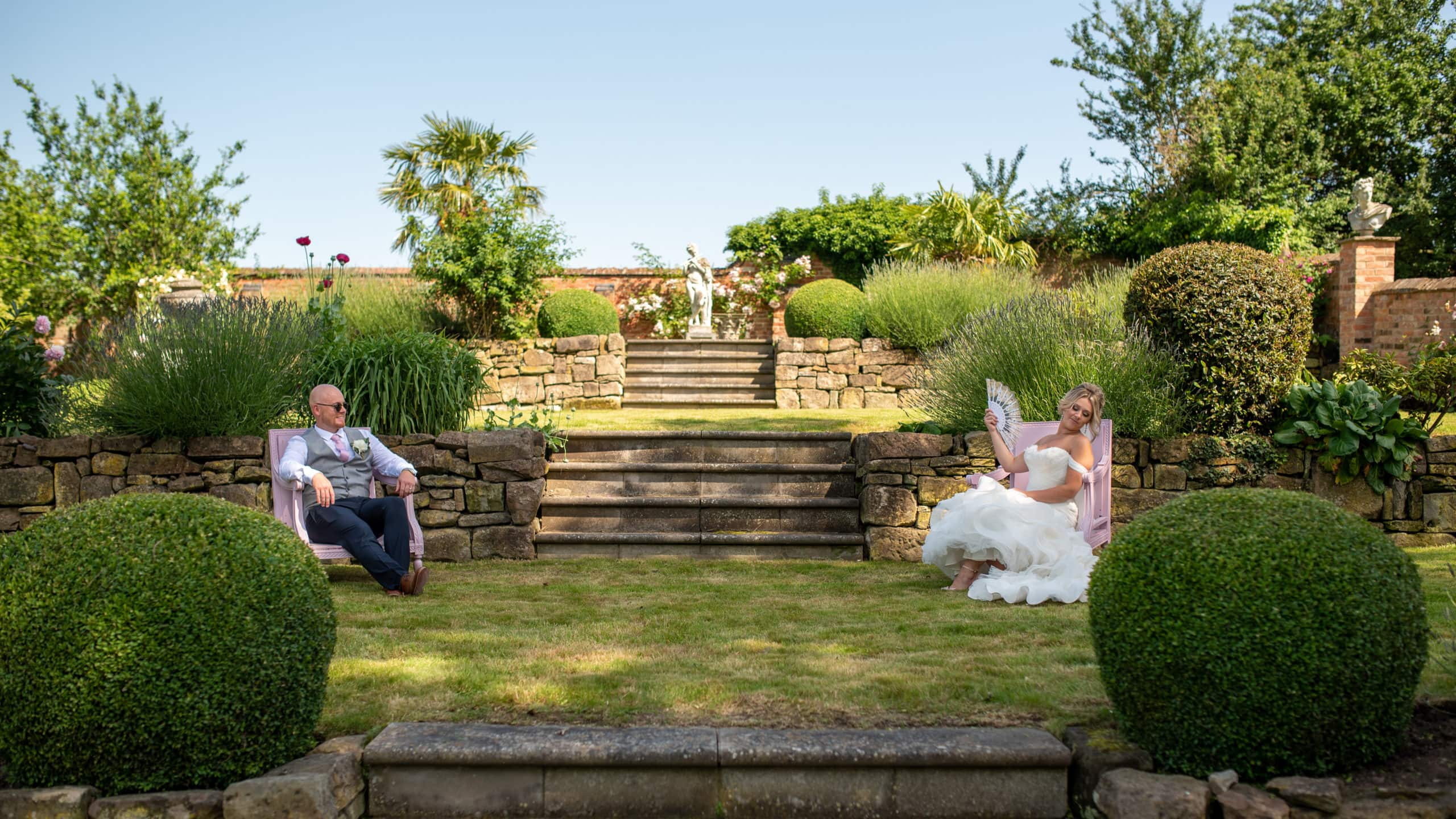 Couple enjoying the sunshine at their Derbyshire wedding venues