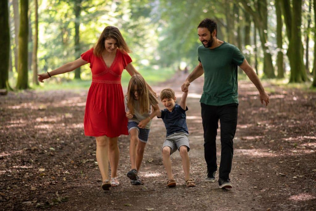 Family enjoying the a woodland photoshoot