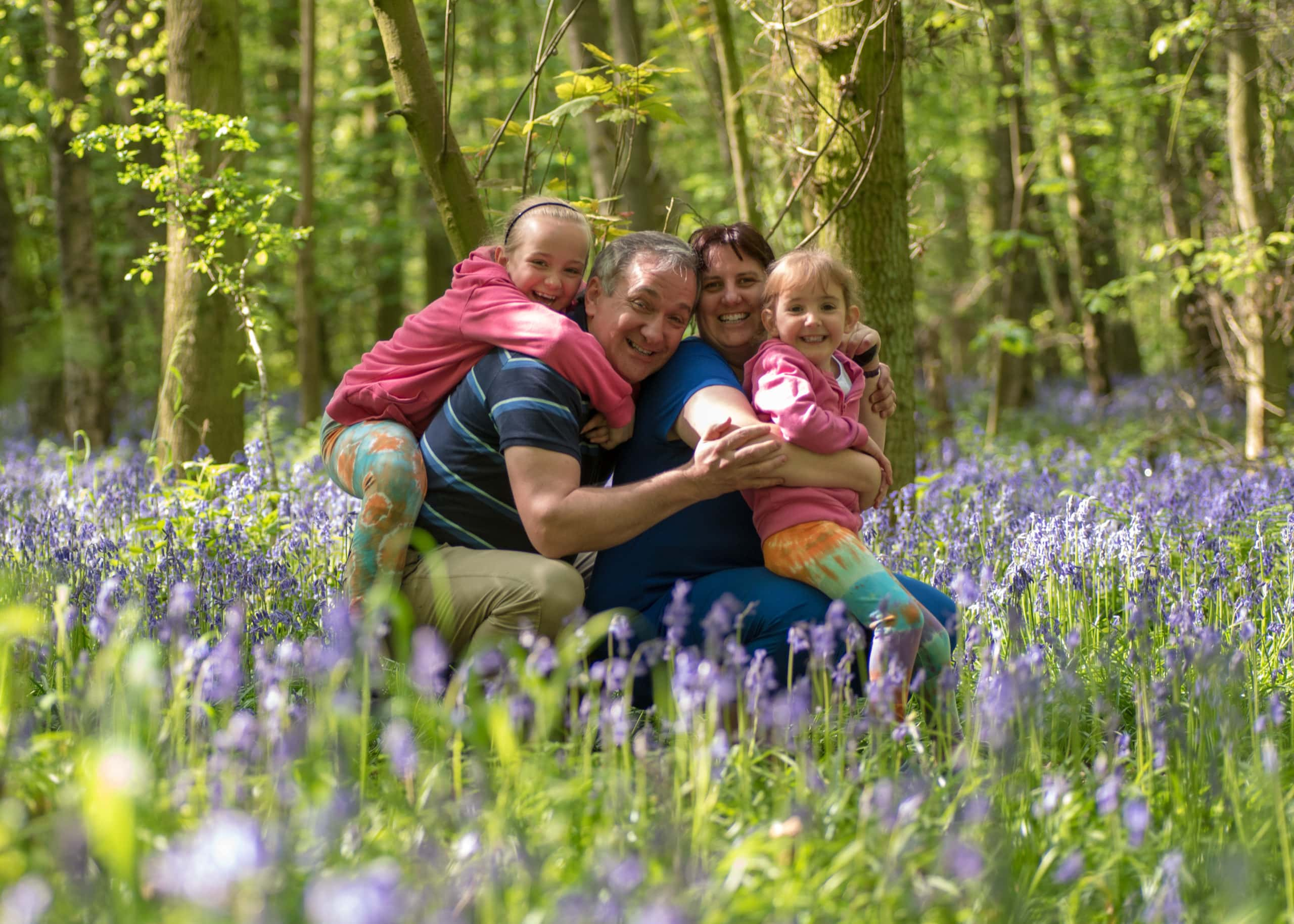 Family portrait in the bluebells