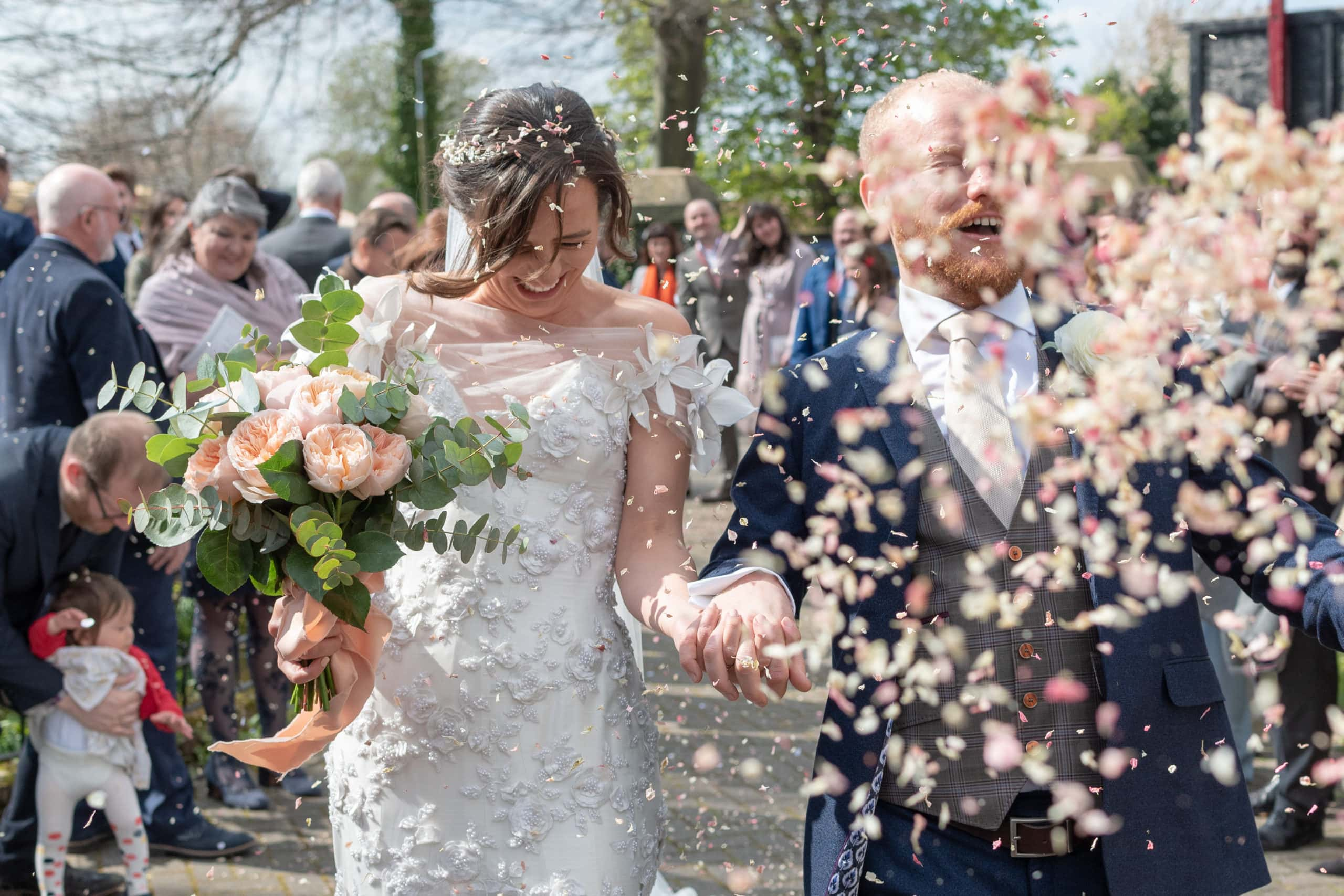 A shower of confetti and a married couple