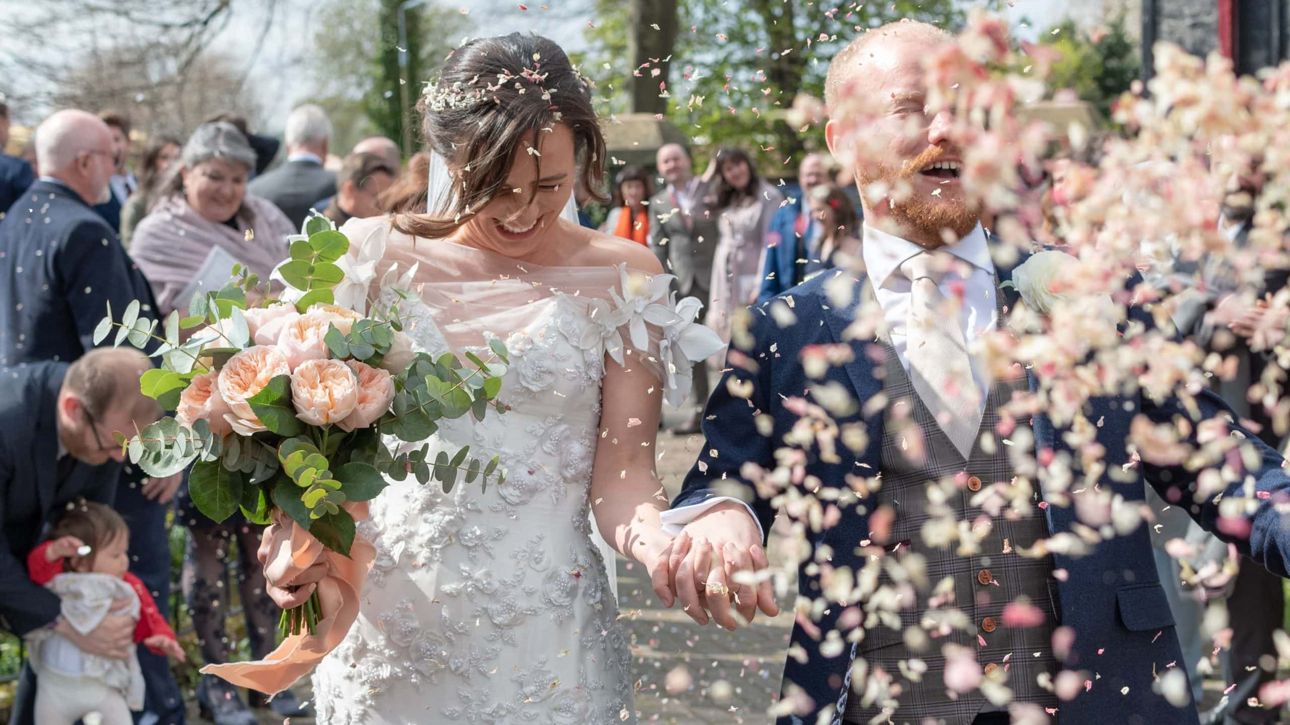 couple walking with a splash of confetti