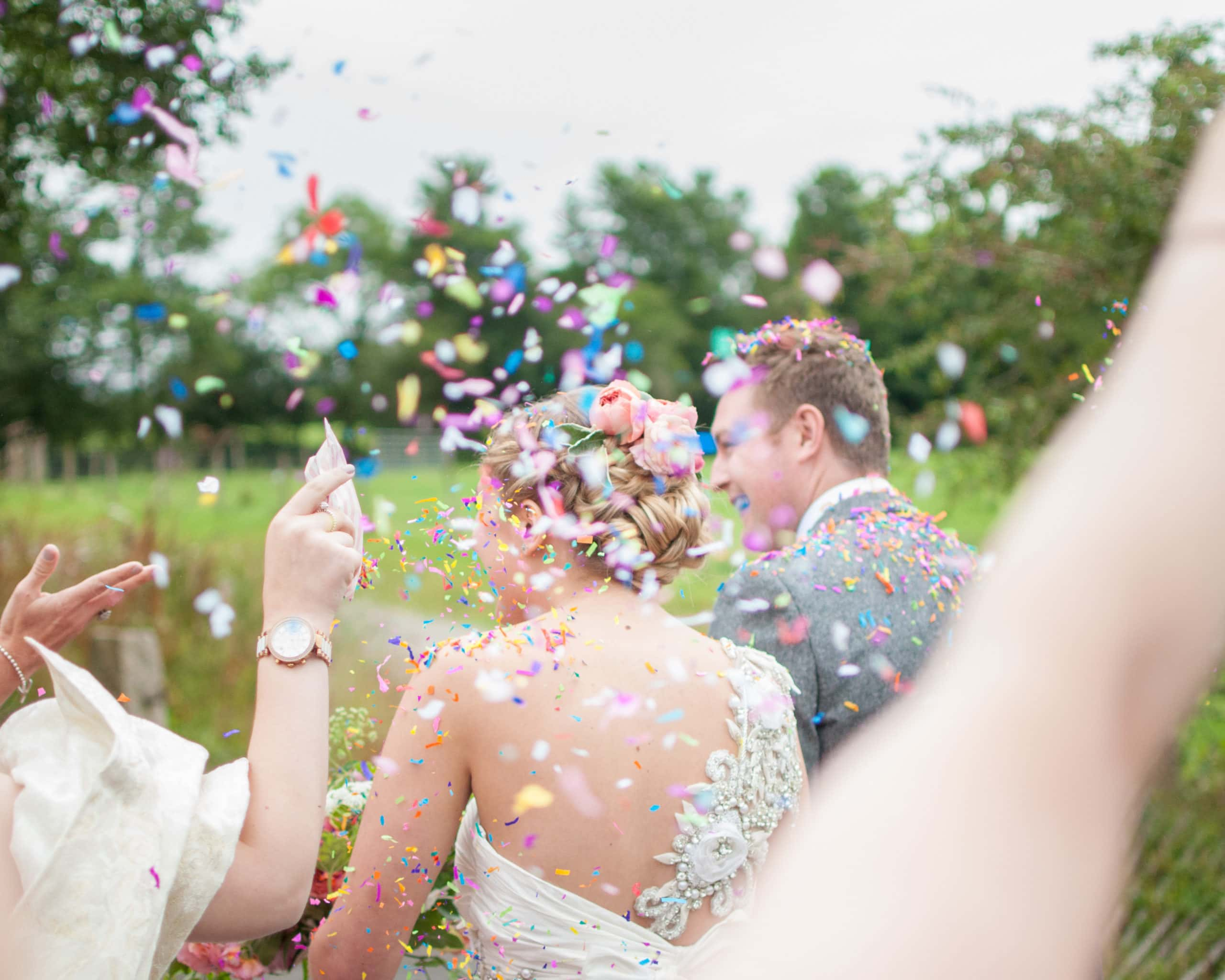 The colour of confetti thrown at a bride and groom.